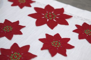 red linen Poinsetiae hand embroidered